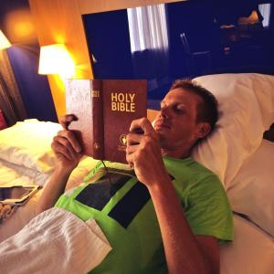 Alessandro De Marchi posting this photo of himself reading a Gideons Hotel Bible with the caption