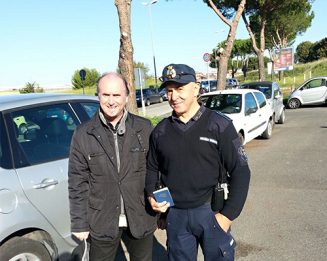 A campus officer in Rome receives a copy of God's Word.
