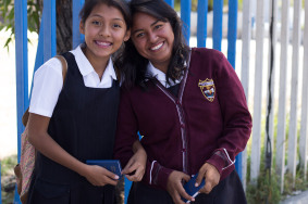 Smiles are shared among students who received New Testaments after school.